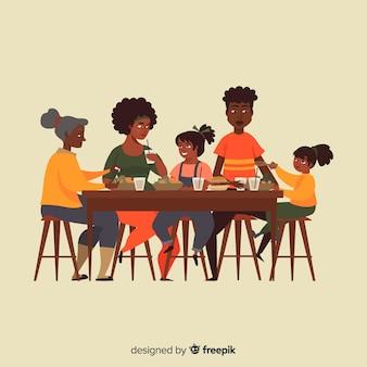 Familie, die um die tabellenillustration sitzt