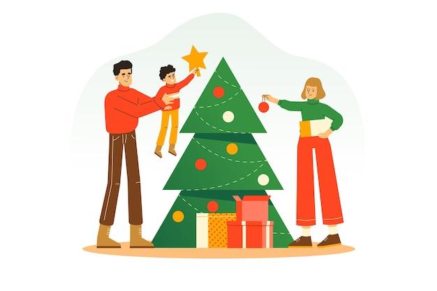 Familie, die weihnachtsbaum zusammen verziert, um weihnachten und neujahrsfeiertag zu feiern