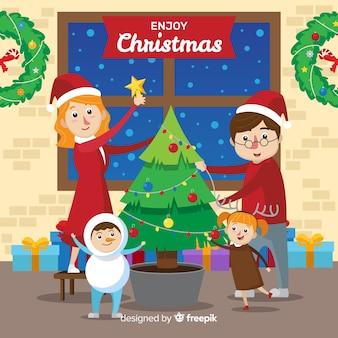 Familie, die weihnachtsbaumhintergrund verziert