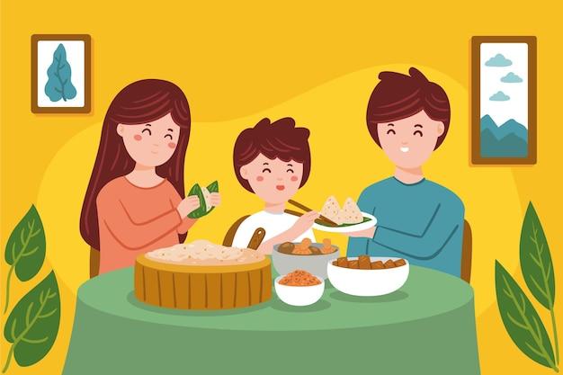 Familie, die zongzi isst