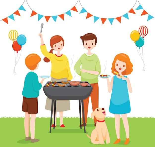 Familie, die zusammen mit grillparty feiert