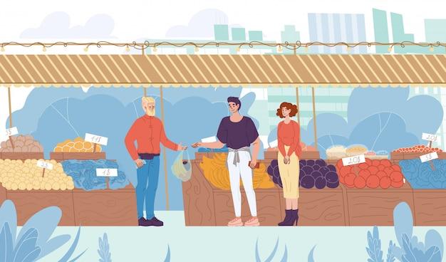 Familie kaufen natürliche öko-produkte auf dem straßenmarkt