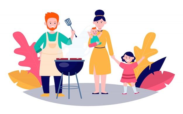 Familie mit kindern, die grillfleisch im freien grillen
