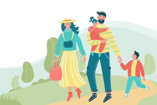 Familie mit kindern, die im park mit einem platz für ihren text spazieren gehen.