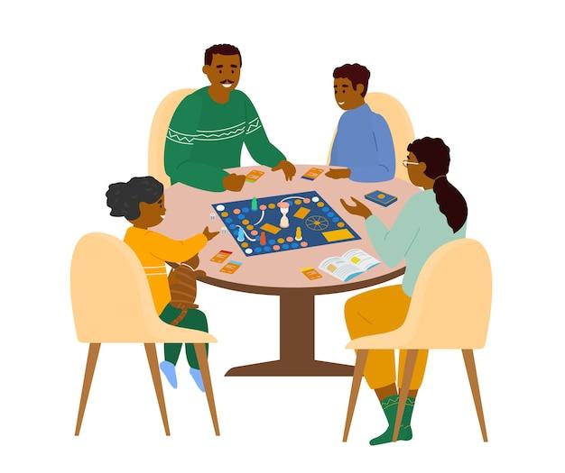 Familie sitzt am tisch und spielt brettspiel zu hause