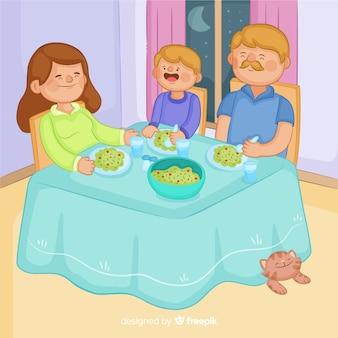 Familie sitzt am tisch