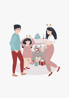 Familie tanzt am weihnachtstag vor dem kamin