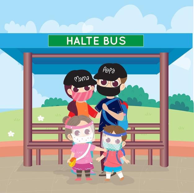 Familie trägt maske wartenden bus