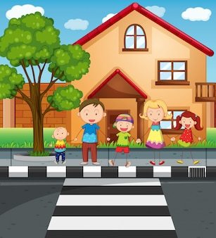 Familienhändchenhalten beim überqueren der straße