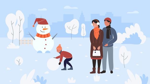 Familienwinter-outdoor-aktivität, lustige schneemann machen, zeit zusammen verbringen