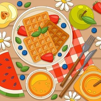Farbige frühstückswaffeln-komposition mit draufsicht auf den hölzernen esstisch mit obstscheiben und honig