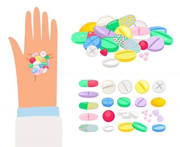 Farbige pillen und tablette in menschlicher hand