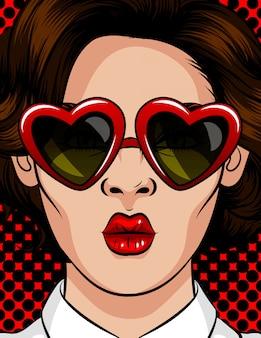 Farbvektorillustration in der pop-arten-art. die frau mit sonnenbrille in form eines herzens. die frau schickt einen kuss. schönheit mit brunettegläsern mit einer art von 60-80s in einem plastikrahmen