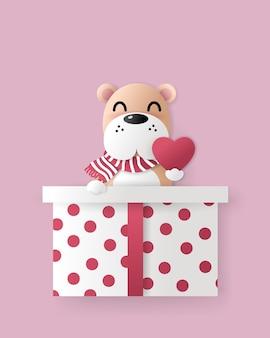 Feier des niedlichen hundes in der großen geschenkbox mit herz.