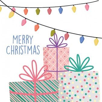 Feierdekorationsgits der frohen weihnachten mit band und lichtern
