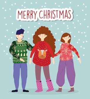 Feierleute der frohen weihnachten, die hässlichen strickjacken tragen, schneien