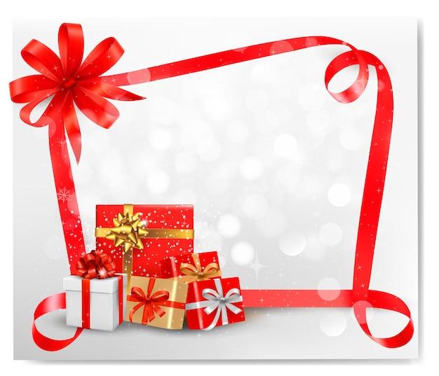 Feiertagshintergrund mit rotem geschenkbogen und geschenkboxen. .