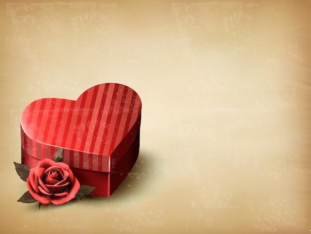 Feiertagsweinlese-valentinstaghintergrund. rote rose mit roter herzförmiger geschenkbox.