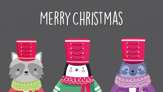 Feierwaschbärpinguin und -mönch der frohen weihnachten versiegeln mit hutschal