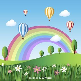 Feld mit regenbogenfrühlingshintergrund