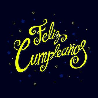 Feliz cumpleanos schriftzug mit festlichen elementen