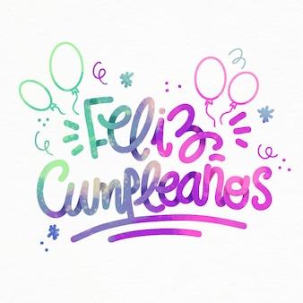 Feliz cumpleaños schriftzug mit luftballons