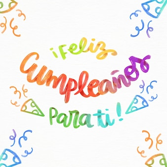 Feliz cumpleaños schriftzug mit partyhüten