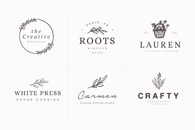 Feminine hand gezeichnete botanische logo-design-vorlagen packen