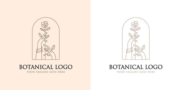 Feminines schönheits-boho-logo mit femininer hand, die blumen-naturlogo-marke premium hält