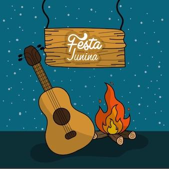 Festa junina mit holzfeuer und gitarre