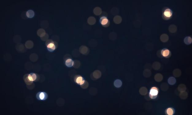 Festlicher blauer leuchtender hintergrund mit bunten lichtern, die bokeh grellen, fliegenden glühenden partikelstaub