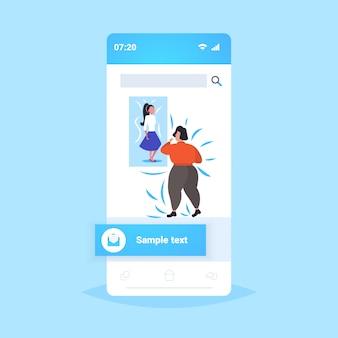 Fette fettleibige frau, die dünne sexy mädchen auf bild übergewichtige dame gewichtsverlust motivation fettleibigkeit konzept smartphone bildschirm online-handy-app