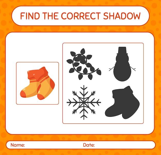 Finden sie das richtige schattenspiel mit socke. arbeitsblatt für kinder im vorschulalter, aktivitätsblatt für kinder