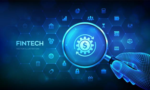 Fintech. finanztechnologiekonzept mit lupe in drahtgitterhand und symbolen.