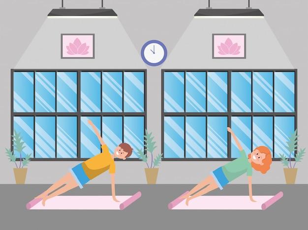 Fit paar praktizierender yoga
