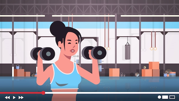 Fitness-blogger macht übungen mit hanteln sportlerin