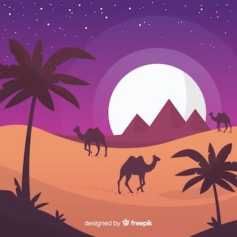 Flache ägypten-pyramiden gestalten mit karawane von kamelen landschaftlich