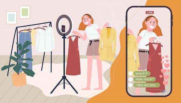 Flache artillustration der karikaturfrauenfigur, die kleidung online verkauft. mädchen, das live-video zu hause mit riesigem smartphone überträgt. konzept von e-commerce, online-verkauf, live-streaming.