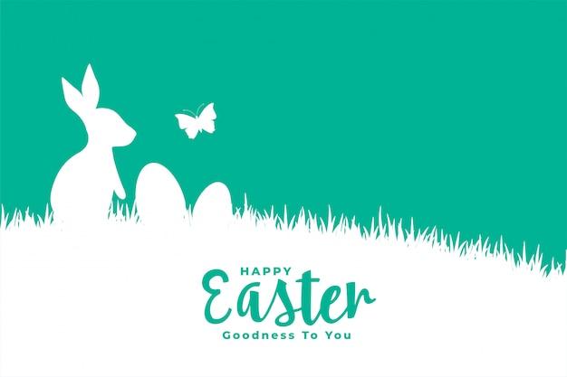 Flache artkarte der glücklichen ostern mit kaninchen auf gras