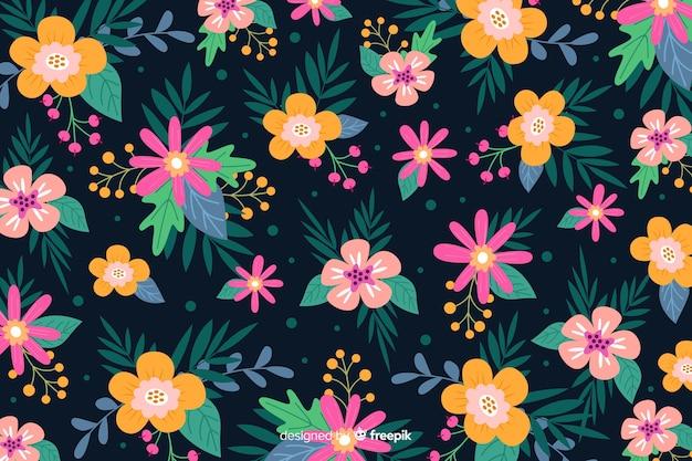 Flache batikart des schönen blumenhintergrundes
