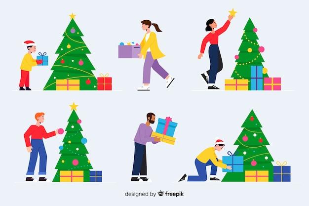 Flache designleute, die weihnachtsbaum verzieren