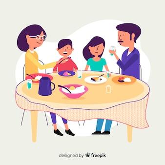 Flache familie, die um tabelle sitzt