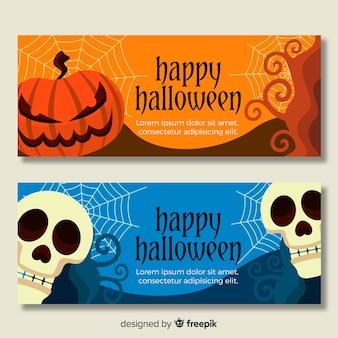 Flache halloween-fahnen mit dem schädel und den kürbisen