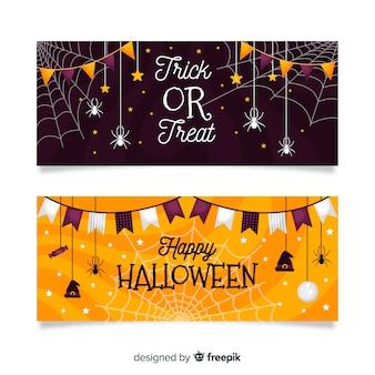 Flache halloween-fahnen mit gespenstischen girlanden