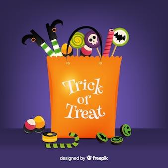 Flache halloween-tasche gefüllt mit bonbons