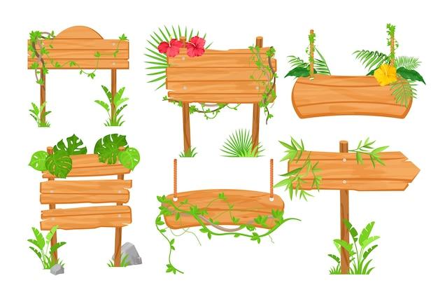 Flache illustrationen des hölzernen dschungel-wegweisers gesetzt. straße zeigt holzbretter und tropische pflanzen