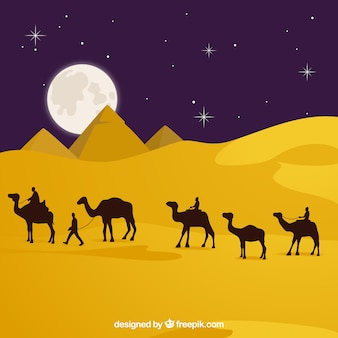 Flache nachtlandschaft mit ägyptischen pyramiden und karawane von kamelen