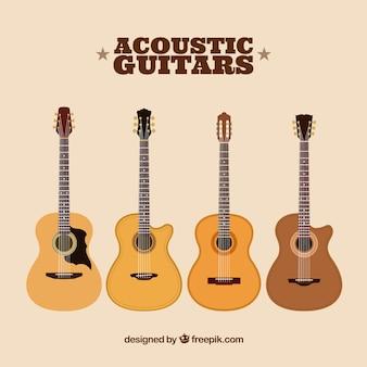 Flache packung mit vier akustikgitarren