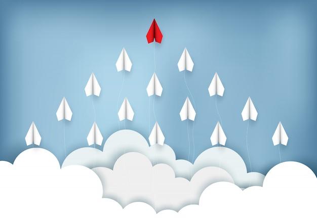 Flache rote und weiße papierfliege bis zum himmel beim fliegen über eine wolke. kreative idee. abbildung cartoon vektor