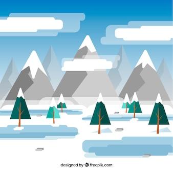 Flache winterlandschaft mit bergen und kiefern
